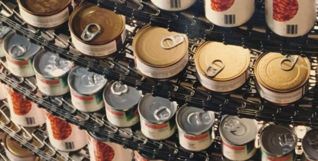 Cans on Metal Belt of an IJ White Mass-Tier Spiral System
